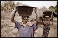 Women Bringing Water To The Village Of Ethiouwar, Bedick Tribe, Senegal