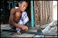 Cutting Wood, Sea gypsies - Bajau Laut, Malaysia