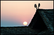 Sunset And Traditional House, Xishuangbanna, China