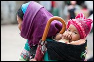 Yi Woman And Baby, Tribal Local Market, China